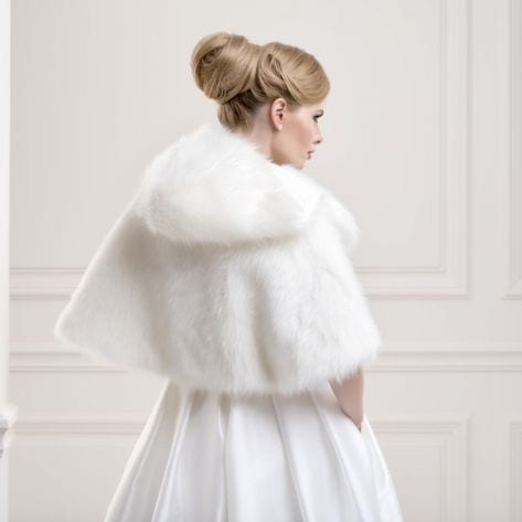 Beautiful jacket made from faux fox fur with three quarter sleeves and with dramatic hood detail for the bride that wants to make an unforgettable statement