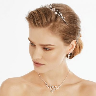 Classical style tiara embellished with glistening rhinestones and crystals.